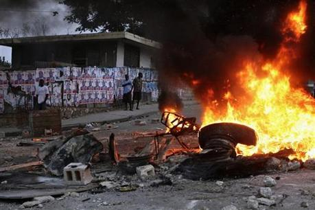 Haiti election protesters rampage, torch building